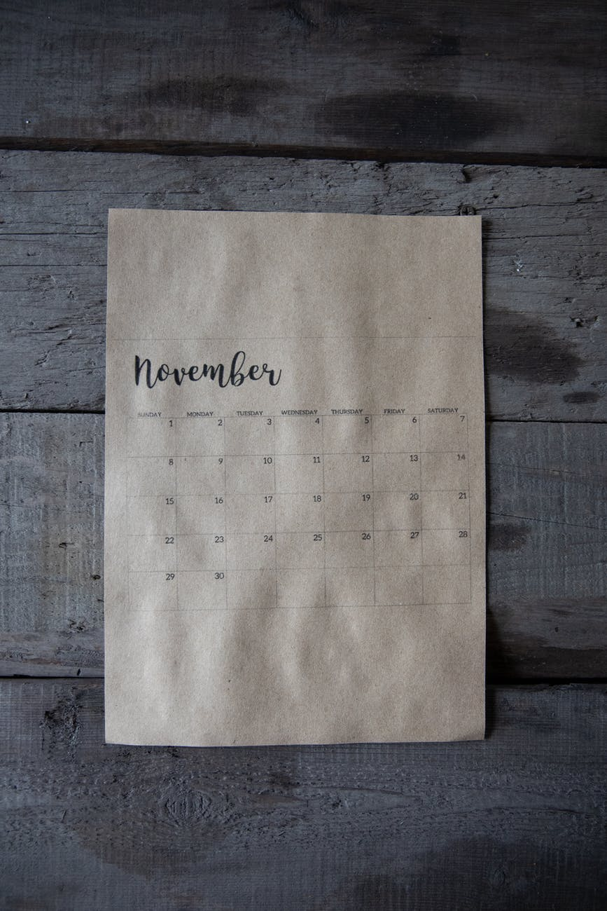 november calendar on gray wooden surface