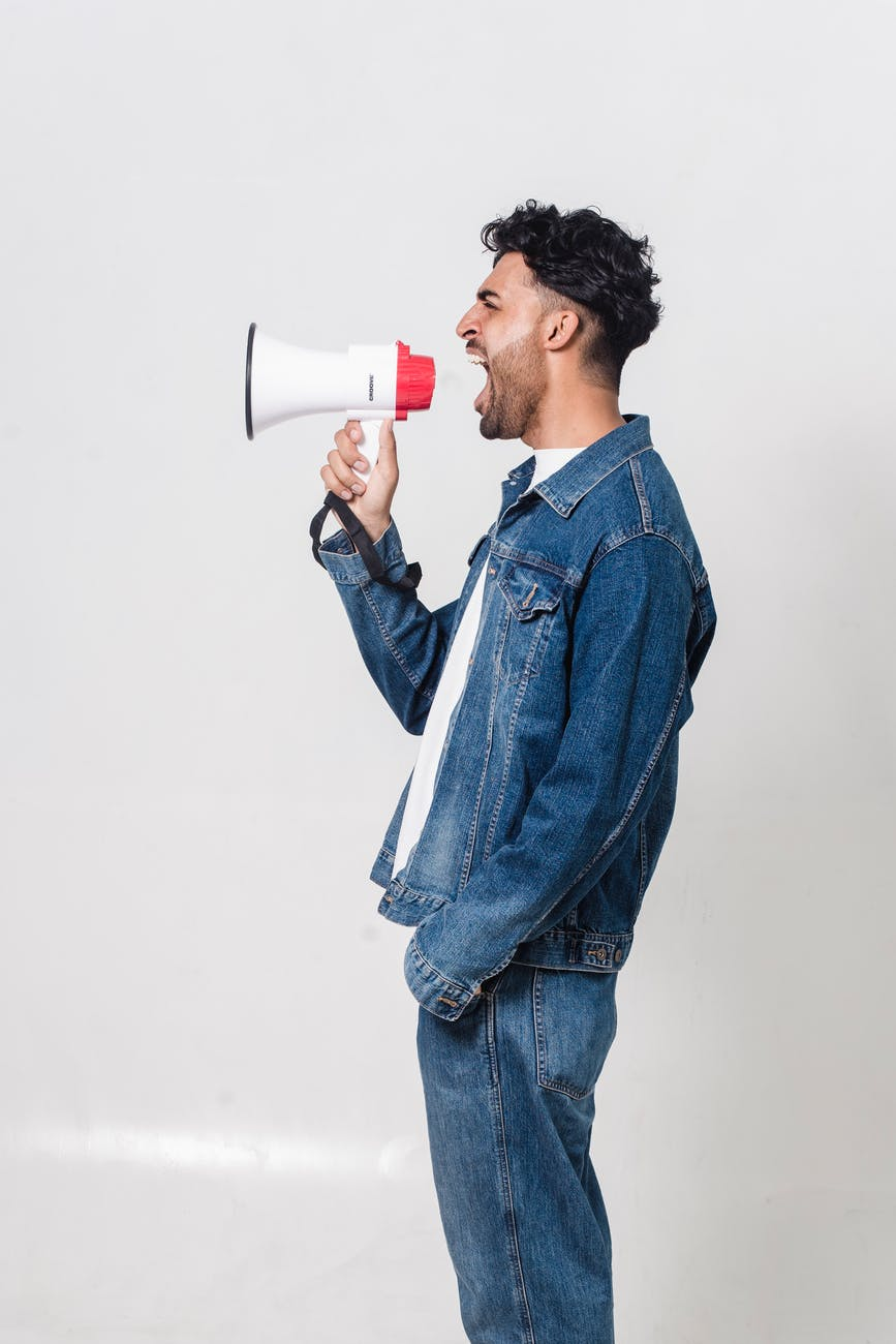 photo of man holding megaphone