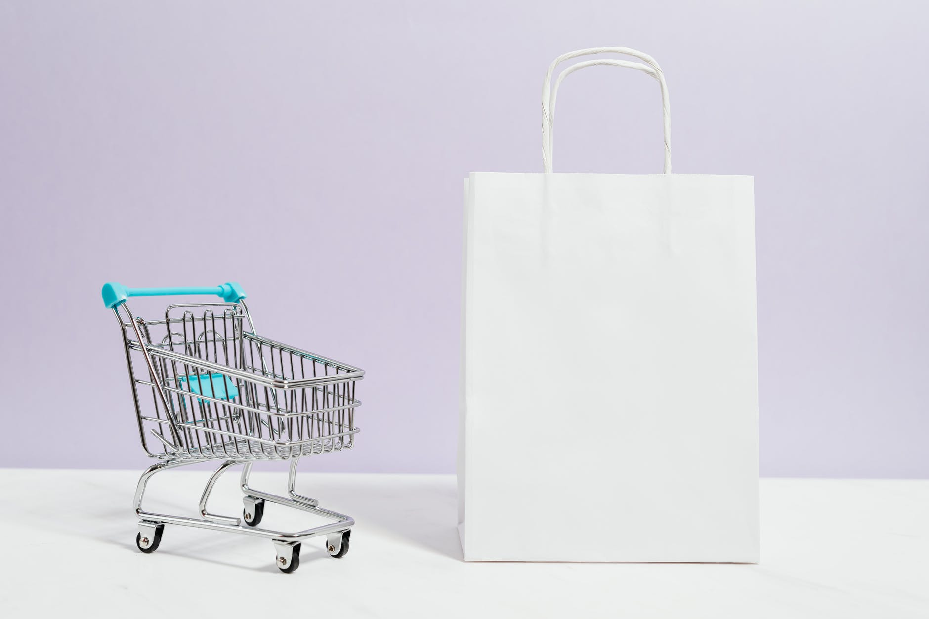 push cart and a white paperbag